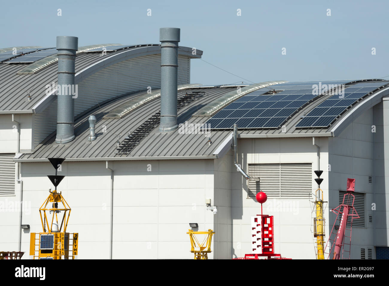 Trinity House warehouse with solar panels fitted to the roof, Harwich, Essex, UK. - Stock Image