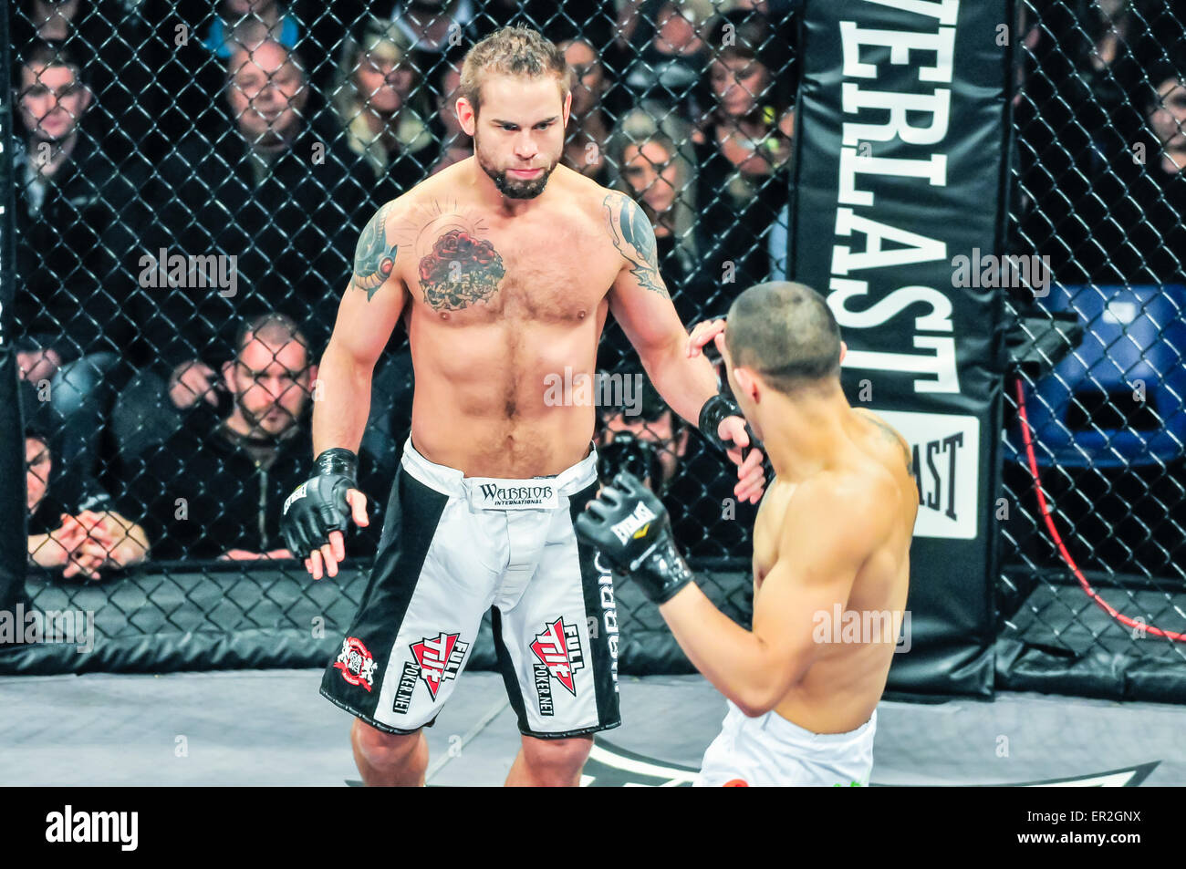 UFC fighter Rich Clementi in the ring at an MMA cage fight against Chris Stringer. - Stock Image
