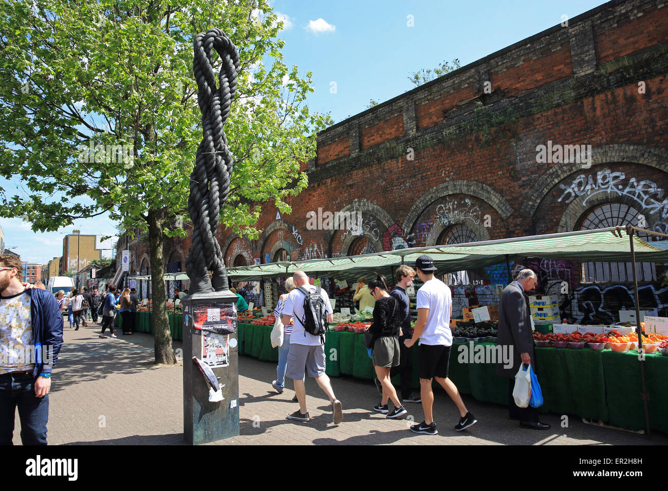 Fruit and vegetable market stalls, on Bethnal Green Road, in trendy Shoreditch, in east London on a summer's - Stock Image