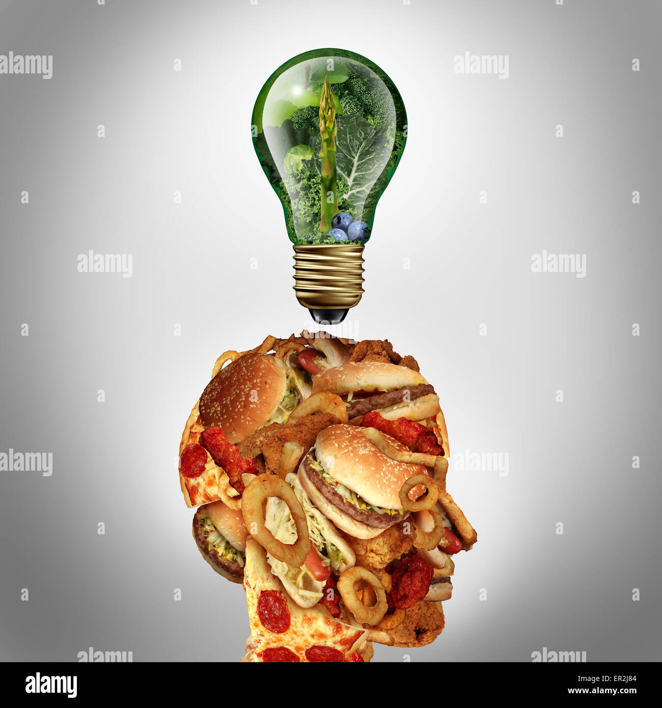 Diet Motivation and dieting inspiration concept as a human head made of greasy junk food with a lightbulb idea icon - Stock Image