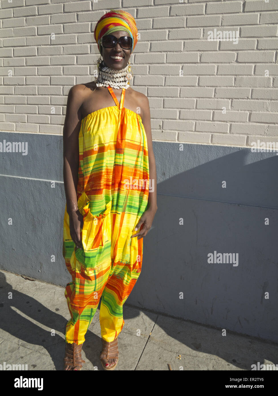Chic Woman Wearing African Inspired Clothing And Jewelry At The Dance Stock Photo Alamy