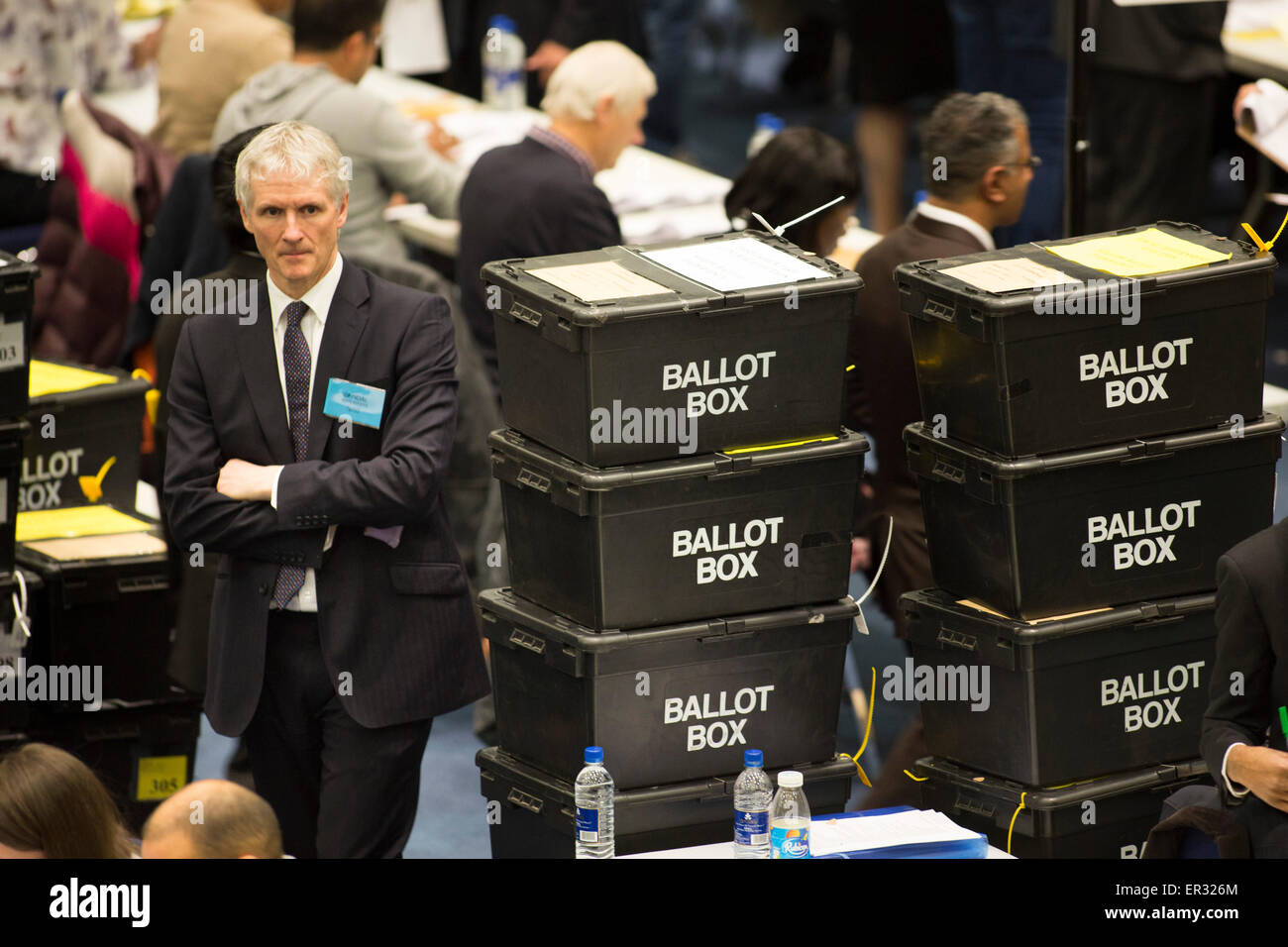 Mark Rogers, Chief Executive of Birmingham City Council leaning on ballot boxes during the General Election count - Stock Image