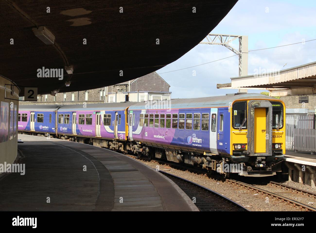 Class153 and 150 diesel units arriving at Carnforth railway station, platform 1, with a train to Morecambe. - Stock Image