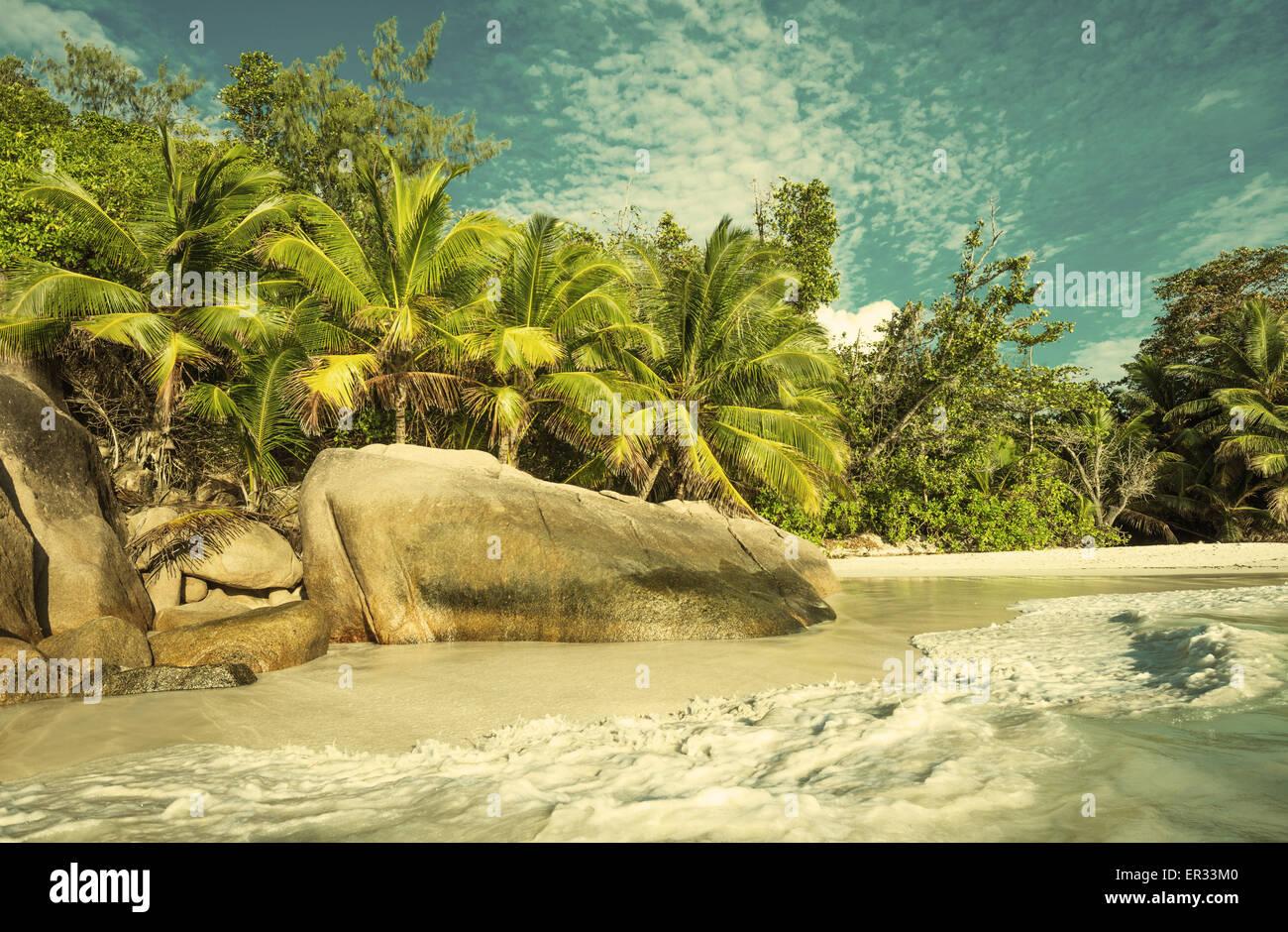 Retro style image of tropical island beach Anse Lazio, Praslin, Seychelles - Stock Image