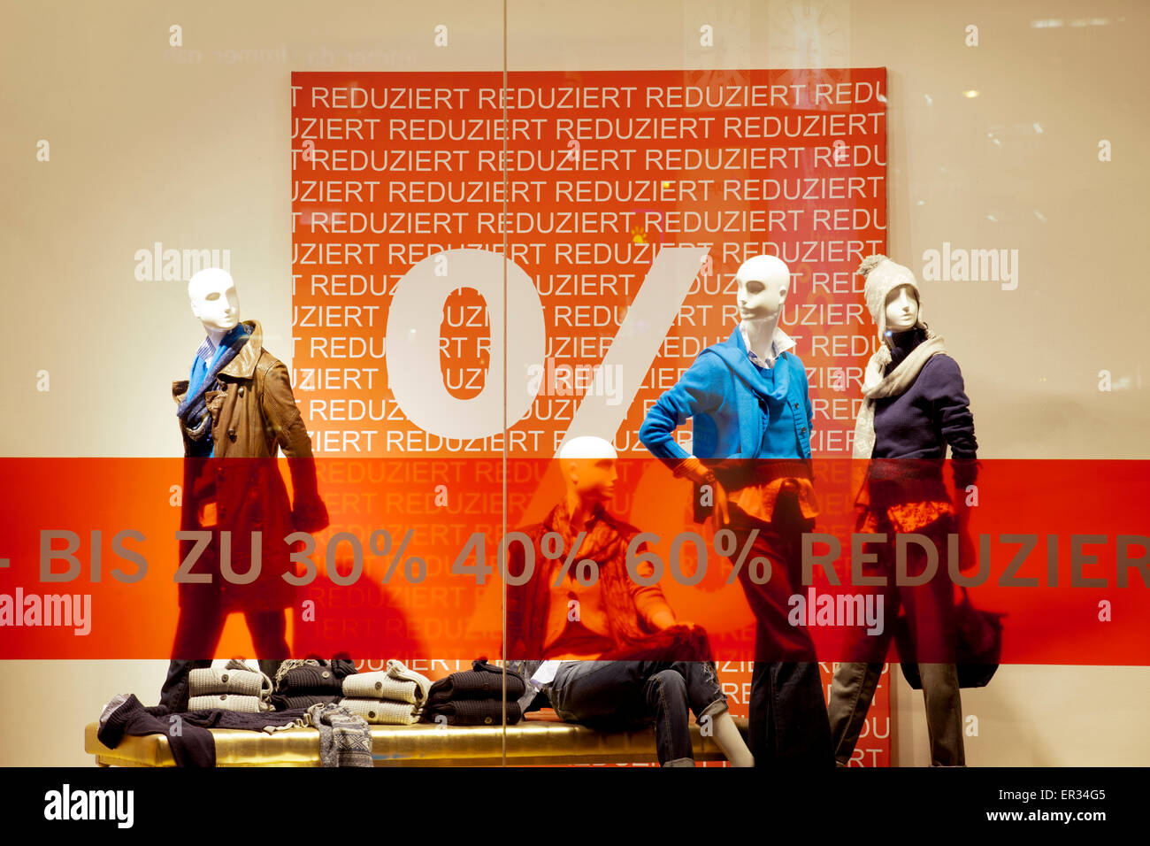 Europe, Germany, North Rhine-Westphalia, Cologne, shop windows with winter sale placards at the shopping street Stock Photo