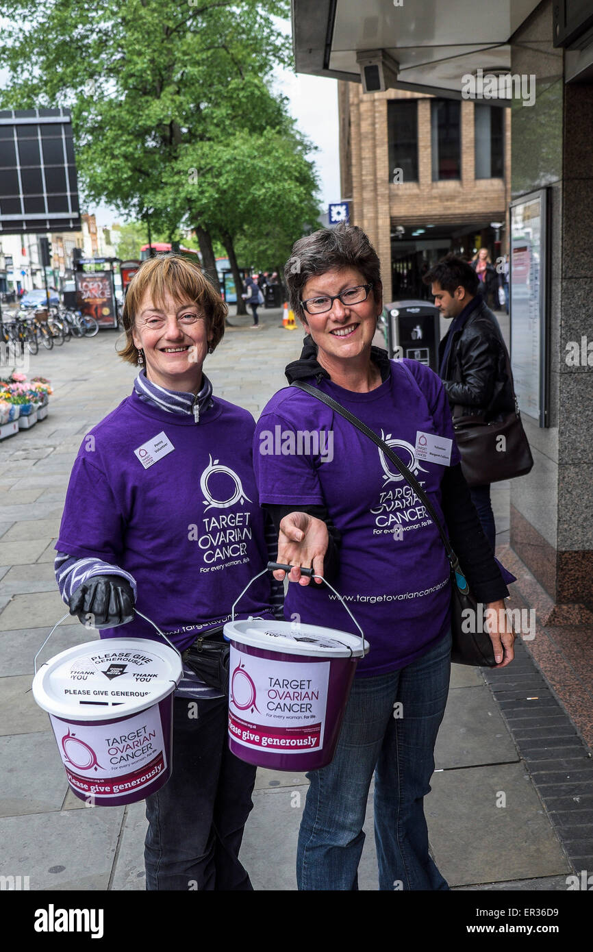 Two women charity workers collecting for Target Ovarian Cancer. - Stock Image