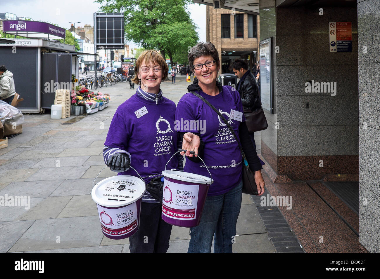 Two cheerful charity workers collecting donations for Target Ovarian Cancer. - Stock Image