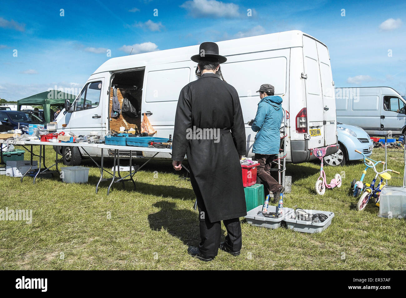 An Orthodox Jew at a boot slae in Essex. - Stock Image