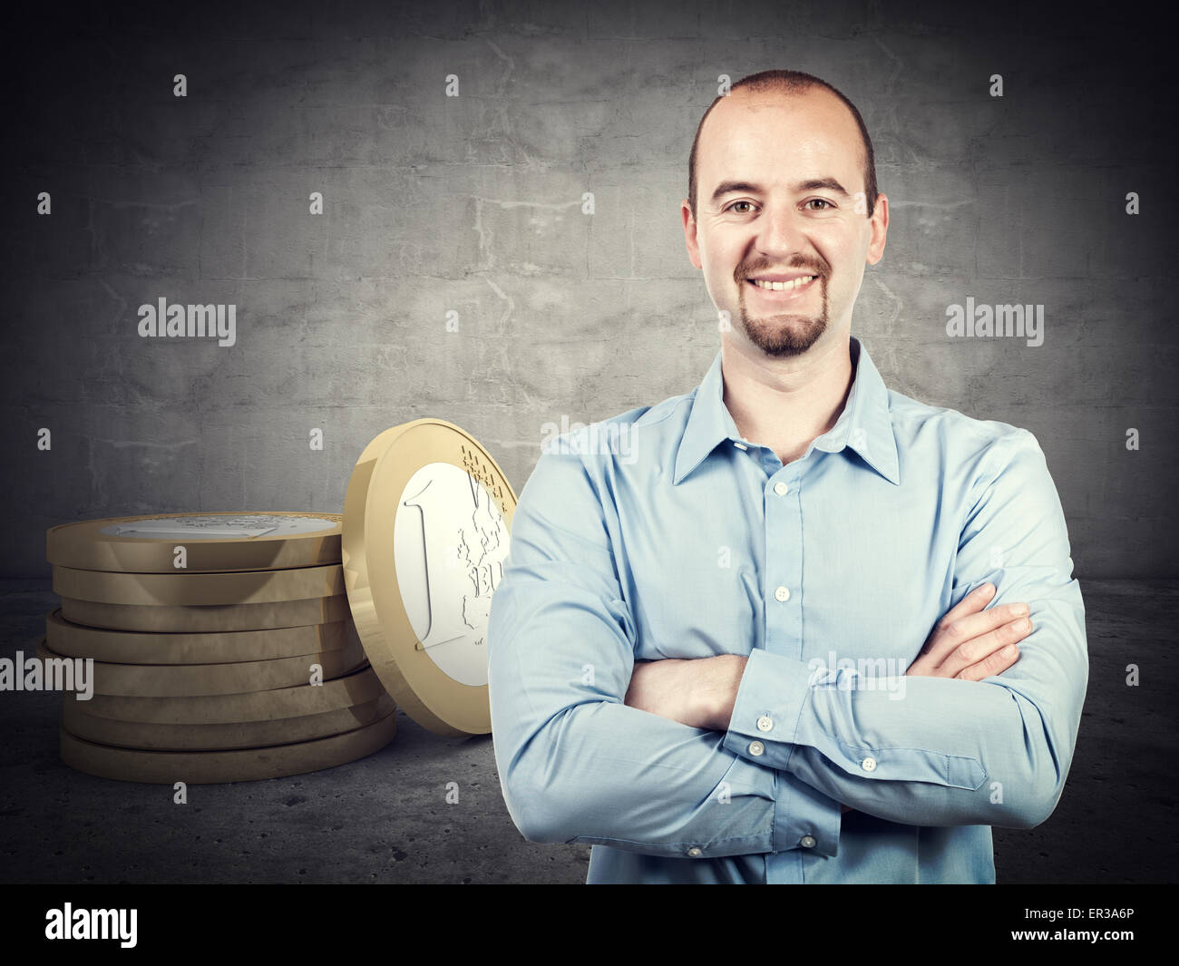 smiling businessman and 3d euro coin - Stock Image