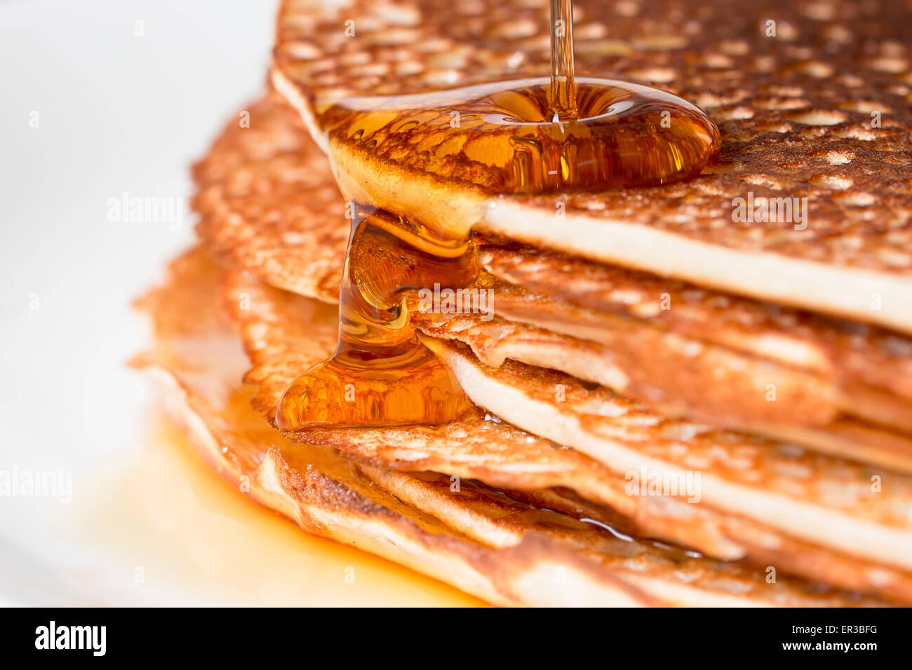 Stack of pancakes with maple syrup - Stock Image