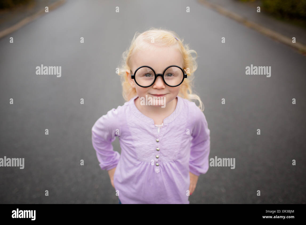 Portrait of a girl wearing silly glasses - Stock Image