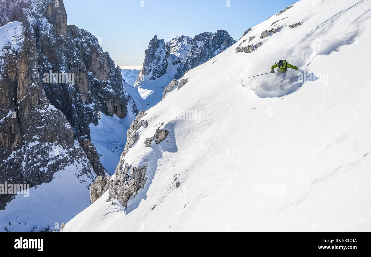 Man skiing off piste, Dolomites, Italy Stock Photo