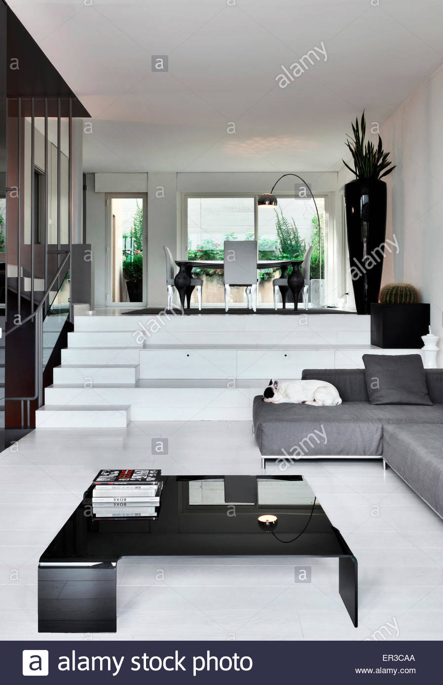 Split level living room in modern apartment, Italy Stock Photo ...