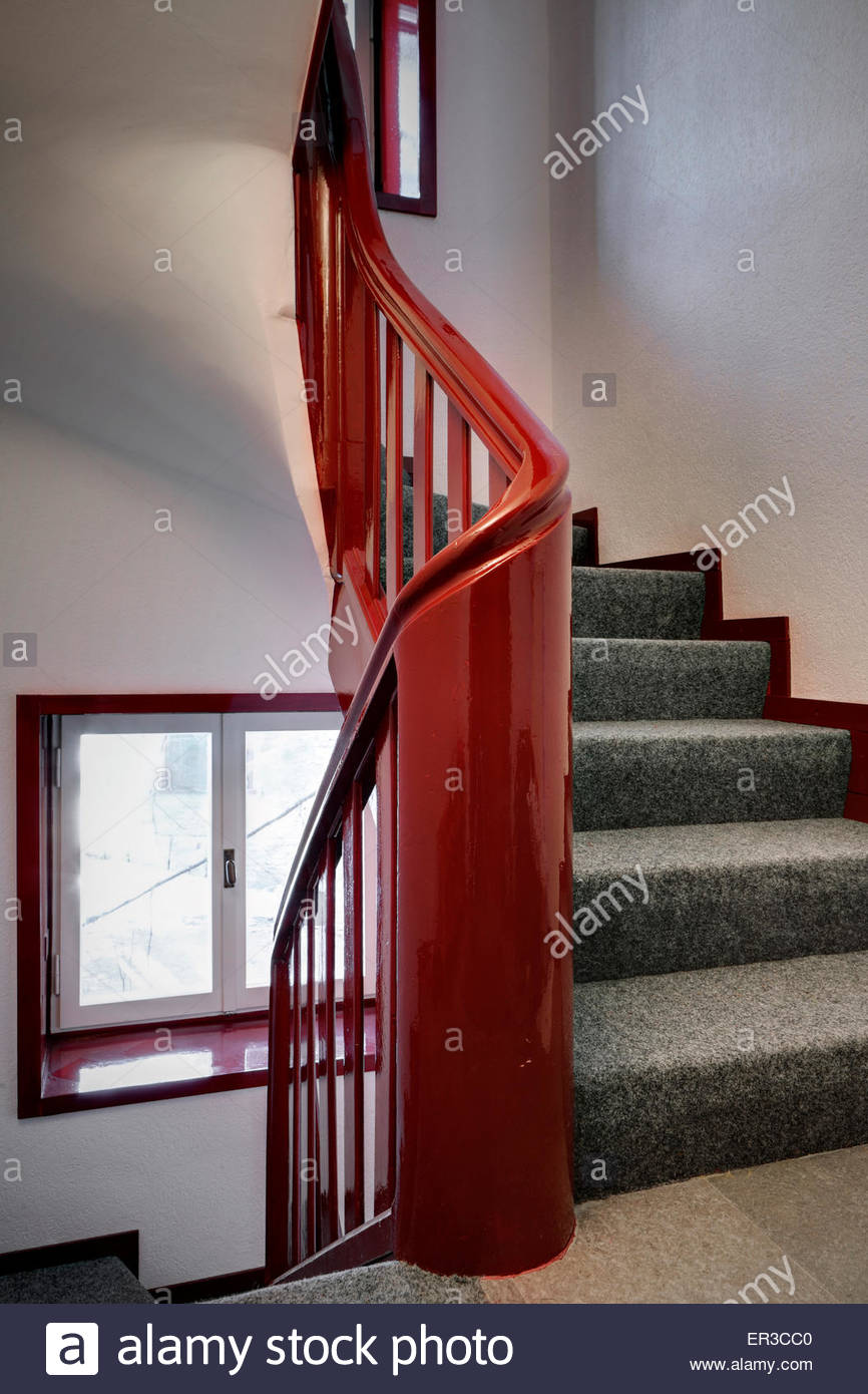 Red Banister And Staircase In Modern Italian Home.