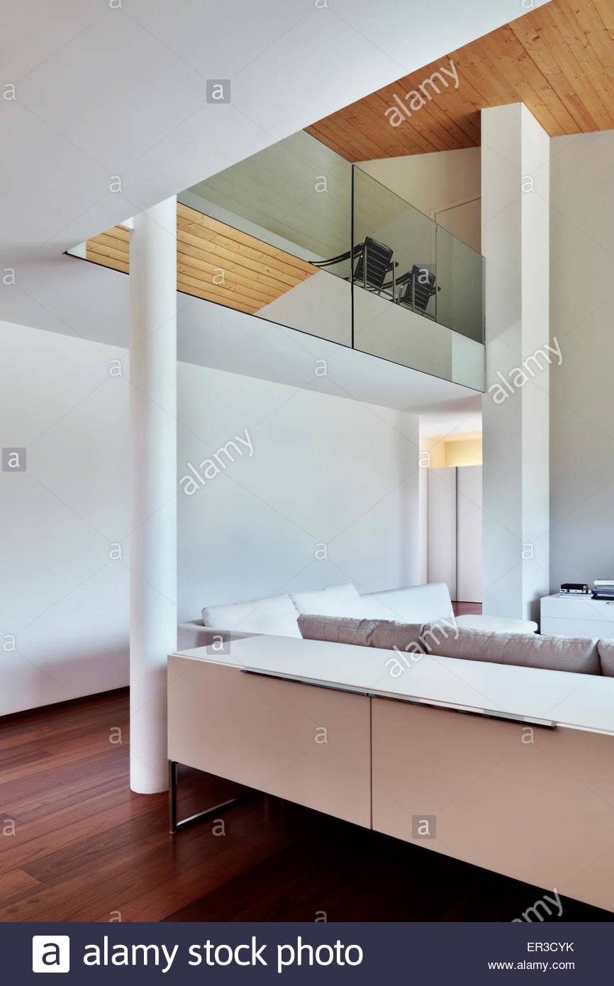Open plan double height living room Villa Garavaglia, Mesaro, Milan, Italy - Stock Image