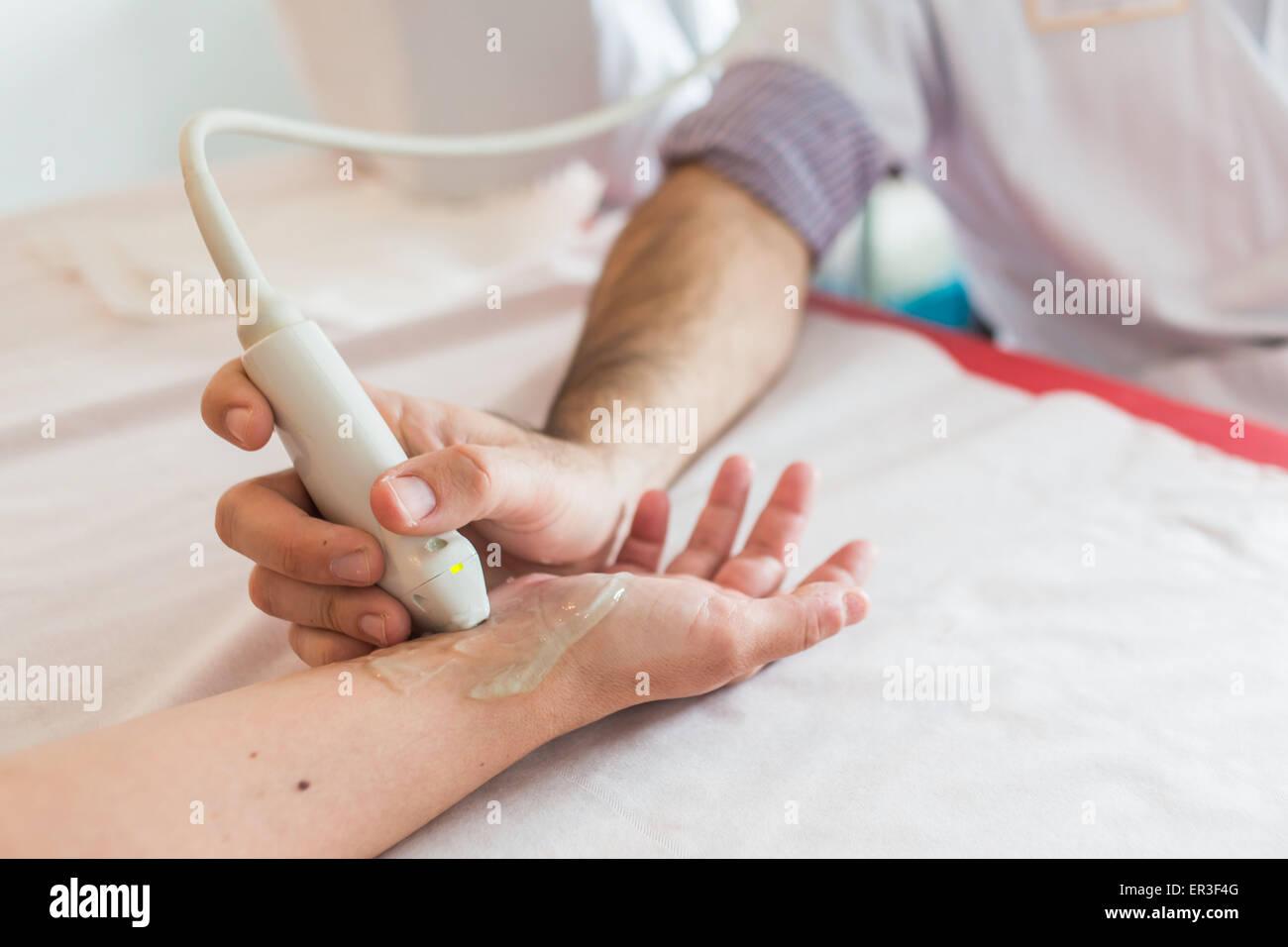Ultrasound carpal tunnel by a rheumatologist. - Stock Image