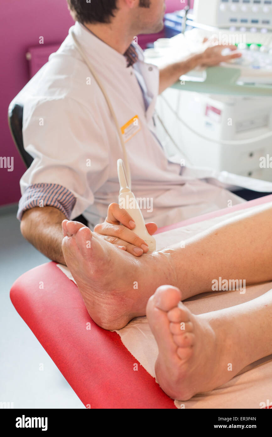 Ultrasound of the ankle of a patient with gout performed by a rheumatologist, Bordeaux hospital, France. - Stock Image