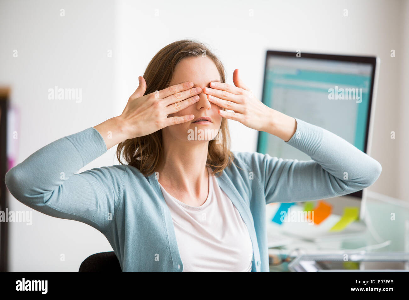 Facial exercise at work. - Stock Image
