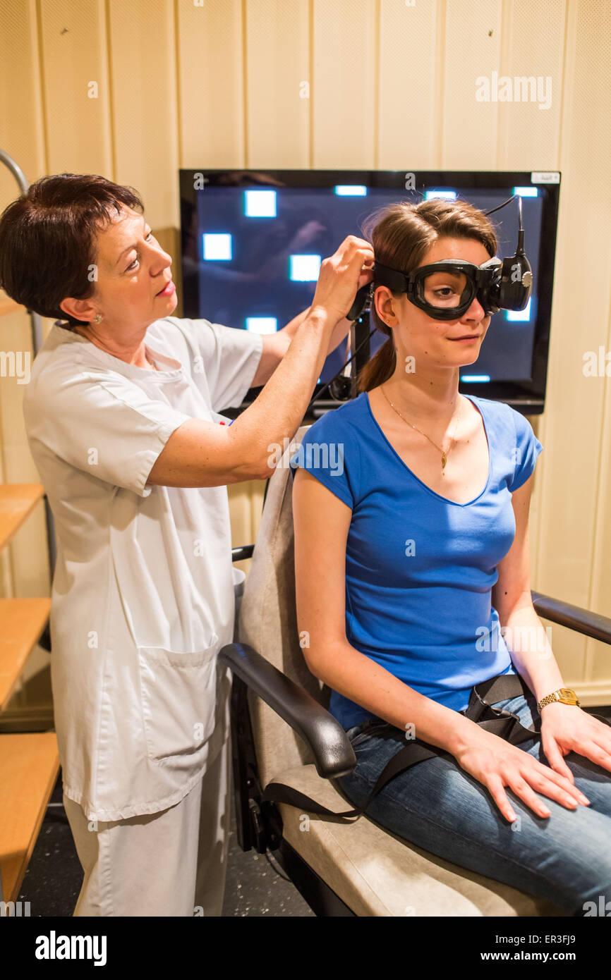 Electronystagmography, eye examination for vertigo screening, Limoges hospital, France. - Stock Image