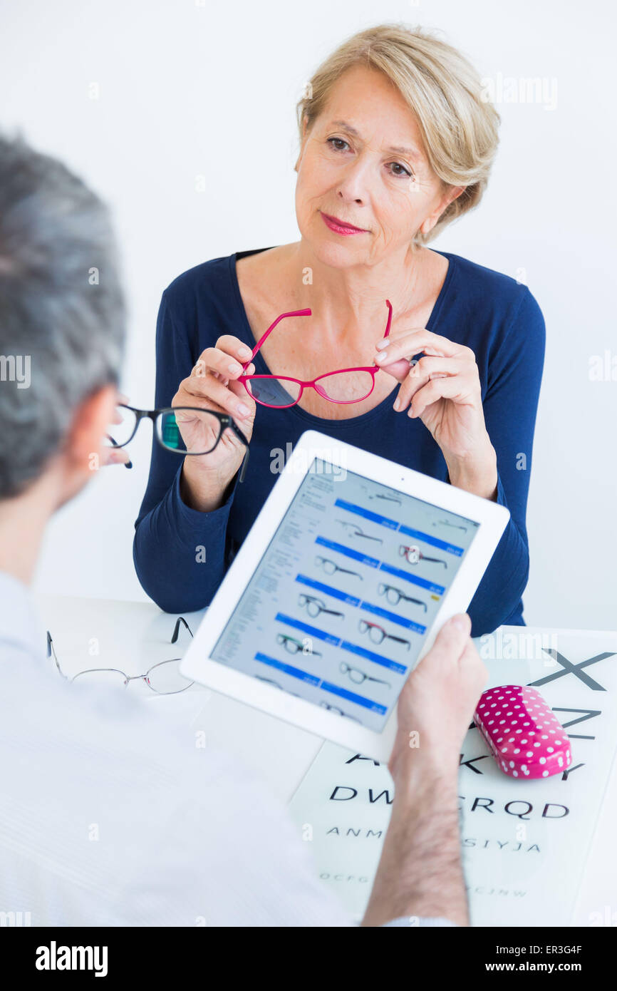 Woman trying virtually online for eyeglasses. - Stock Image