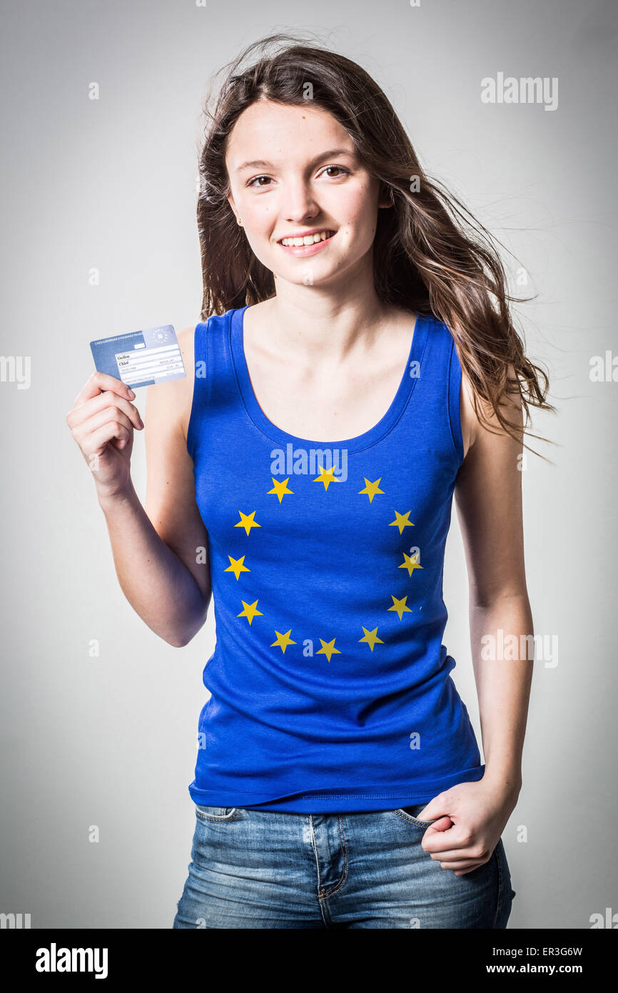 Woman with European Health Insurance Card. The European Health Insurance Card (EHIC) allows to get healthcare through - Stock Image