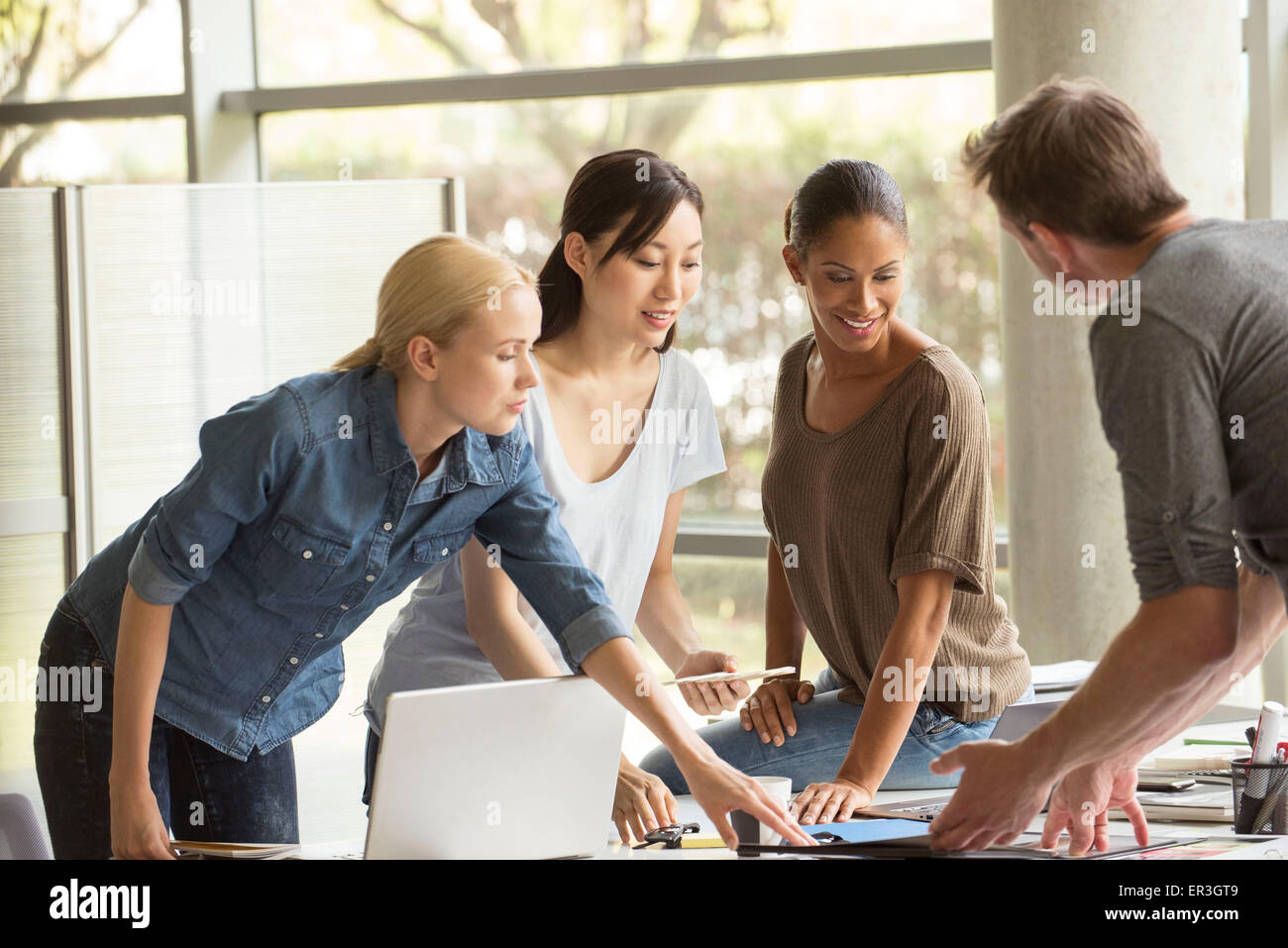 Project team working closely on assignment - Stock Image