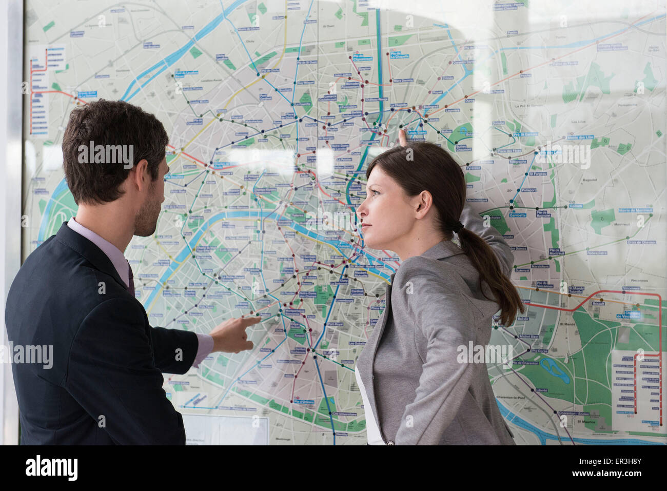 Man and woman planning route on Paris metro Stock Photo