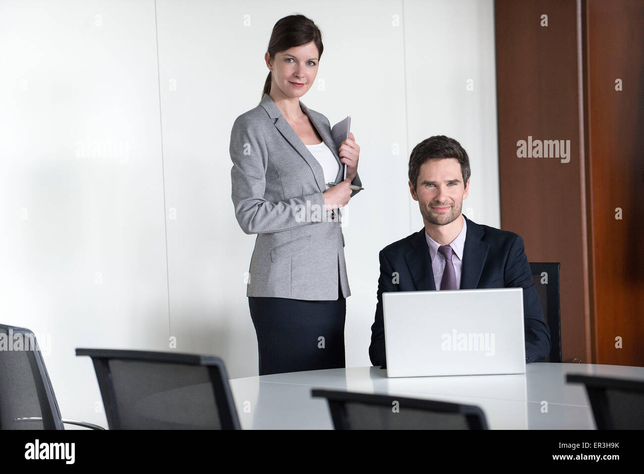 Business team members preparing for presentation - Stock Image