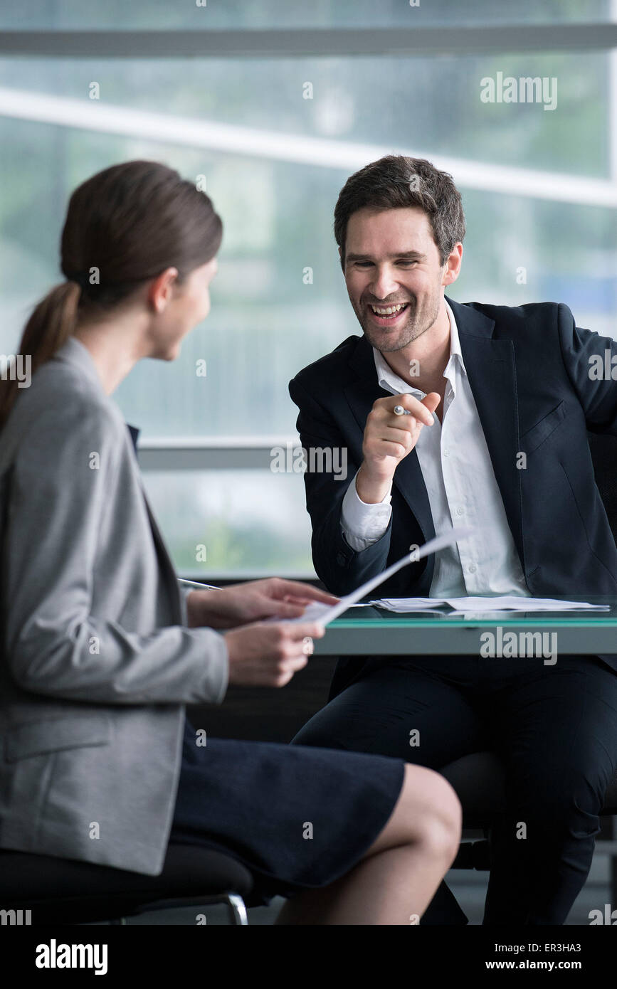 Businessman man having lighthearted meeting with client - Stock Image