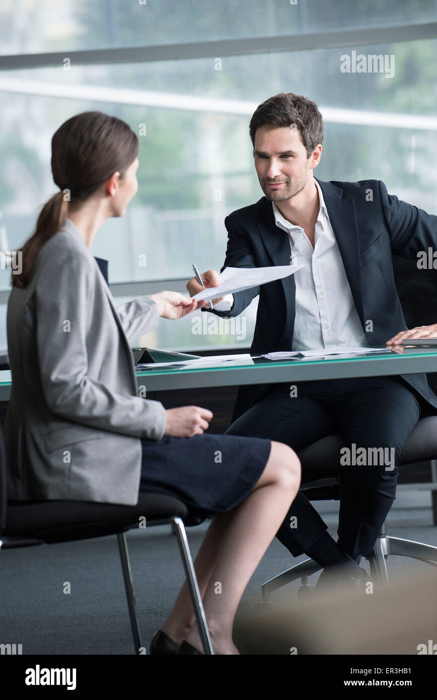 Businessman handing document to client - Stock Image