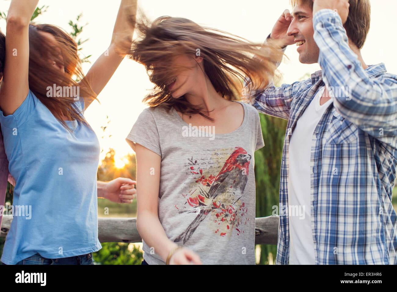 Friends partying together outdoors - Stock Image