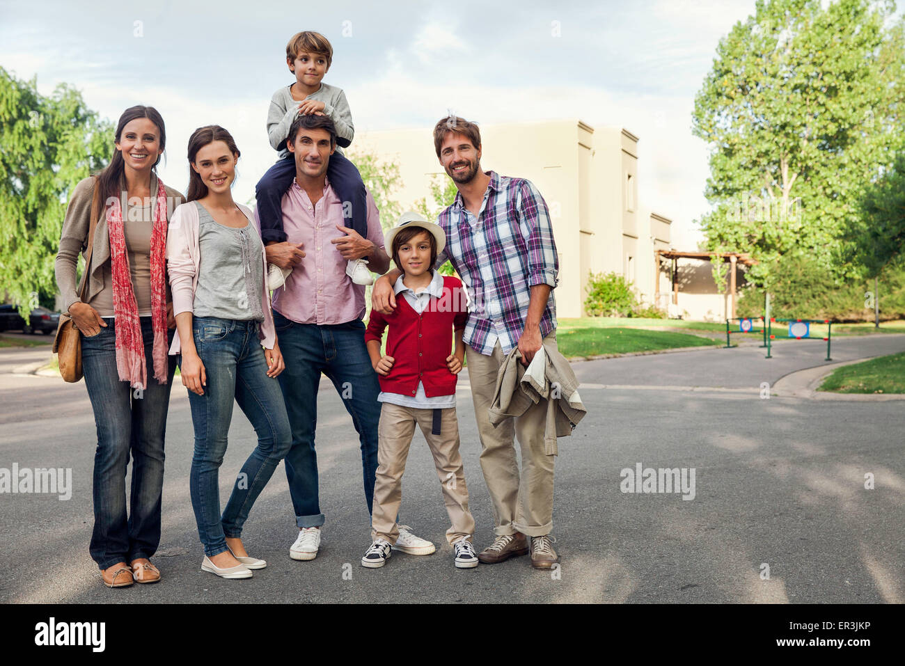Family posing for group portrait outdoors Stock Photo