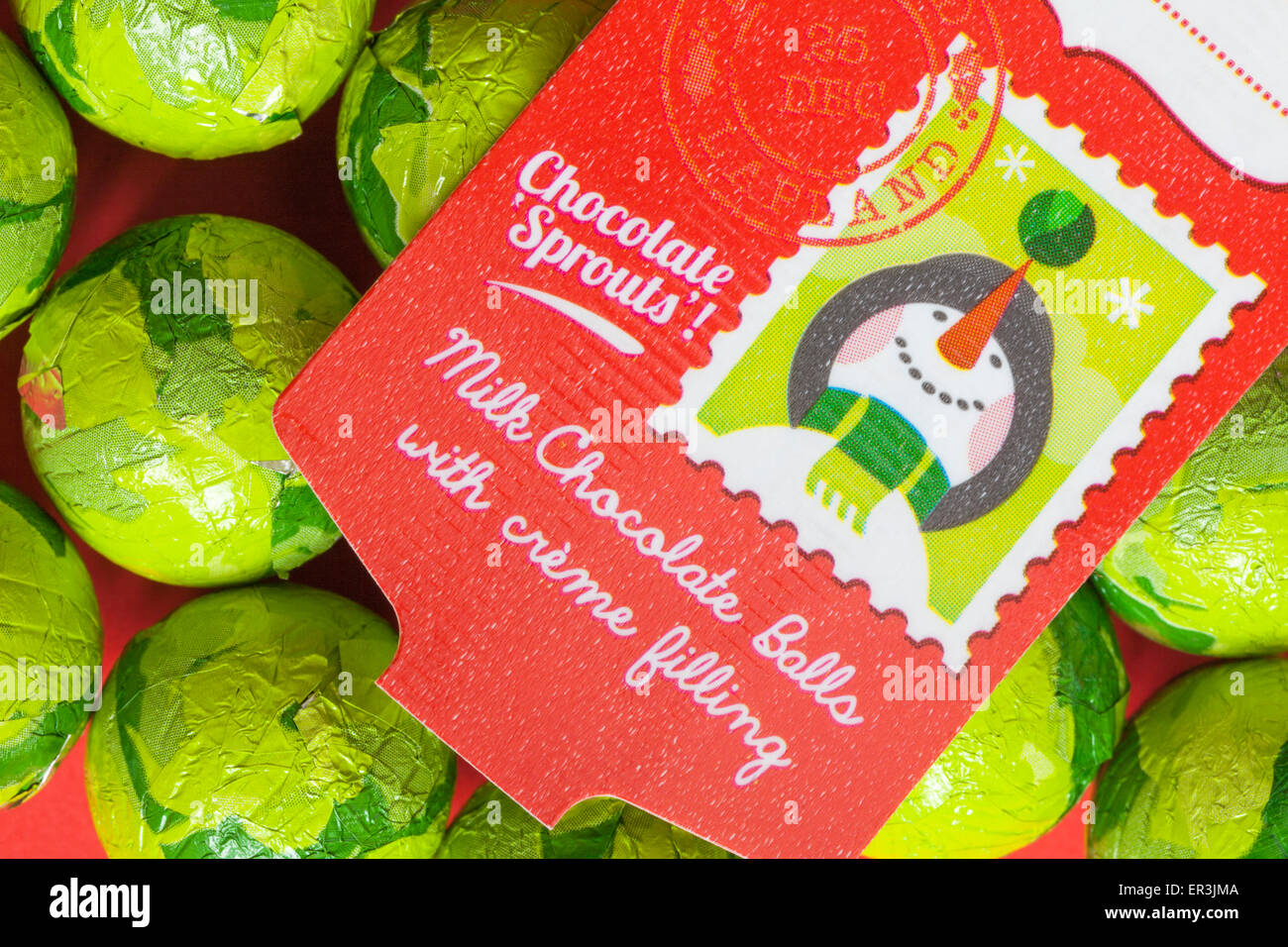 Christmas foil wrapped chocolate sprouts - milk chocolate balls with creme filling ready for Christmas - Stock Image
