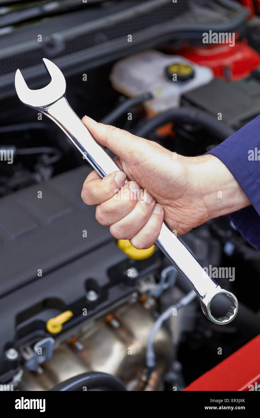 Mechanic Holding Spanner Fixing Car Engine - Stock Image