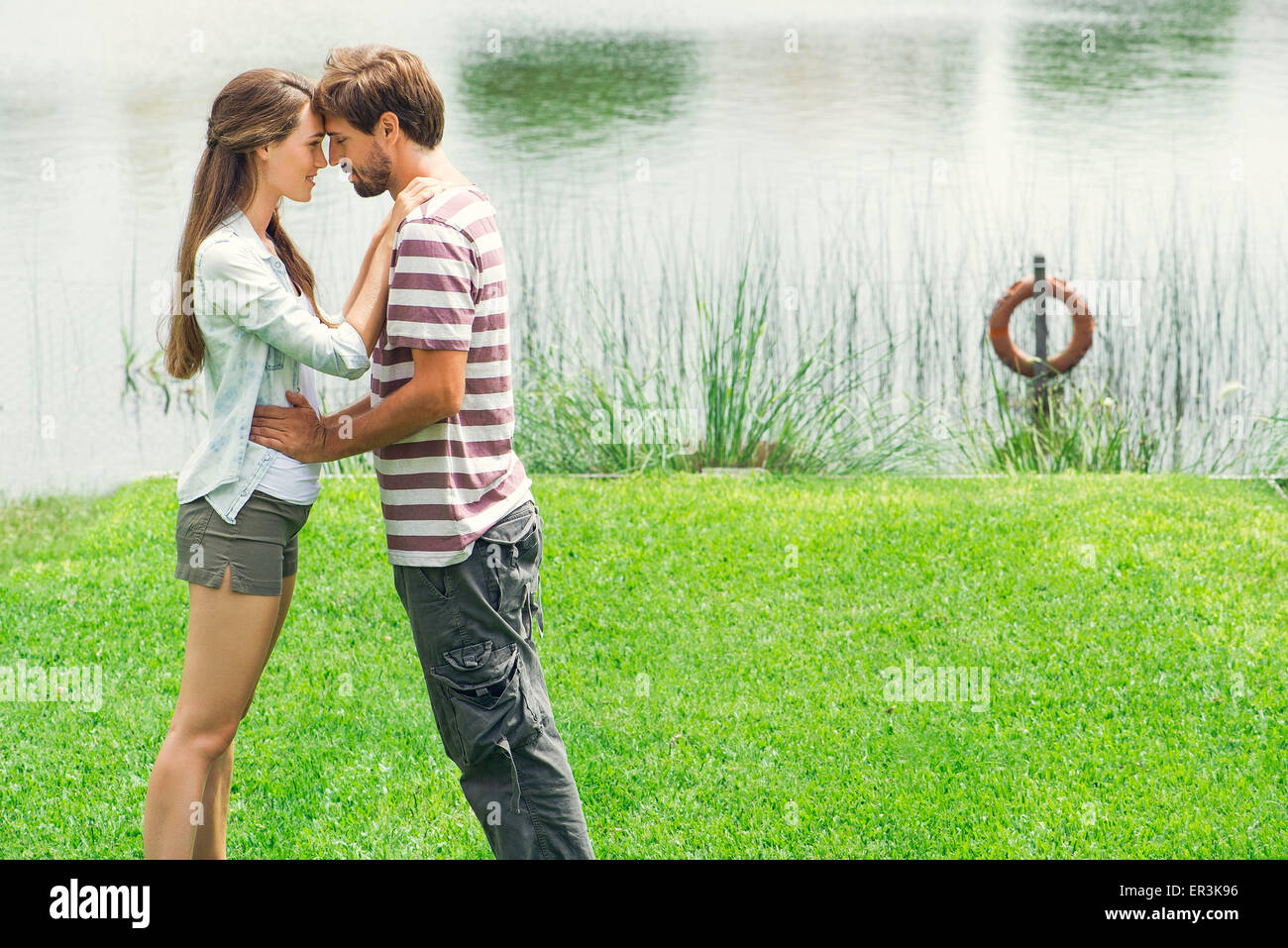 Young couple embracing outdoors - Stock Image