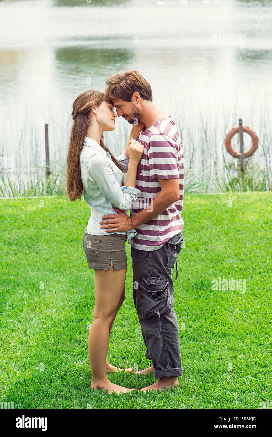 Young couple embracing outdoors Stock Photo