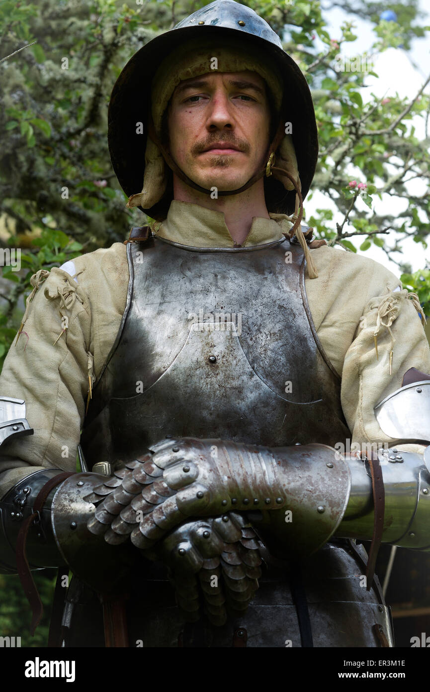 Medieval soldier wearing helmet, brestplate and gauntlets - Stock Image