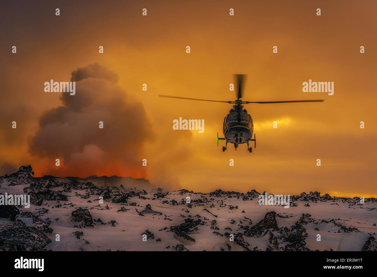 Helicopter flying by the volcano eruption at the Holuhraun Fissure, Bardarbunga Volcano, Iceland. - Stock Image