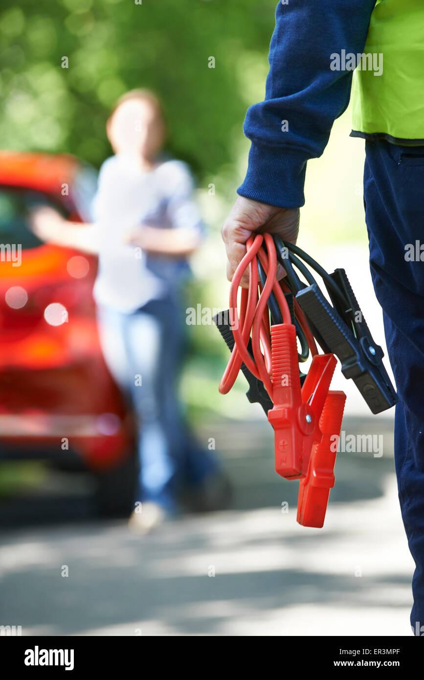 Mechanic Attending Car Breakdown On Country Road - Stock Image