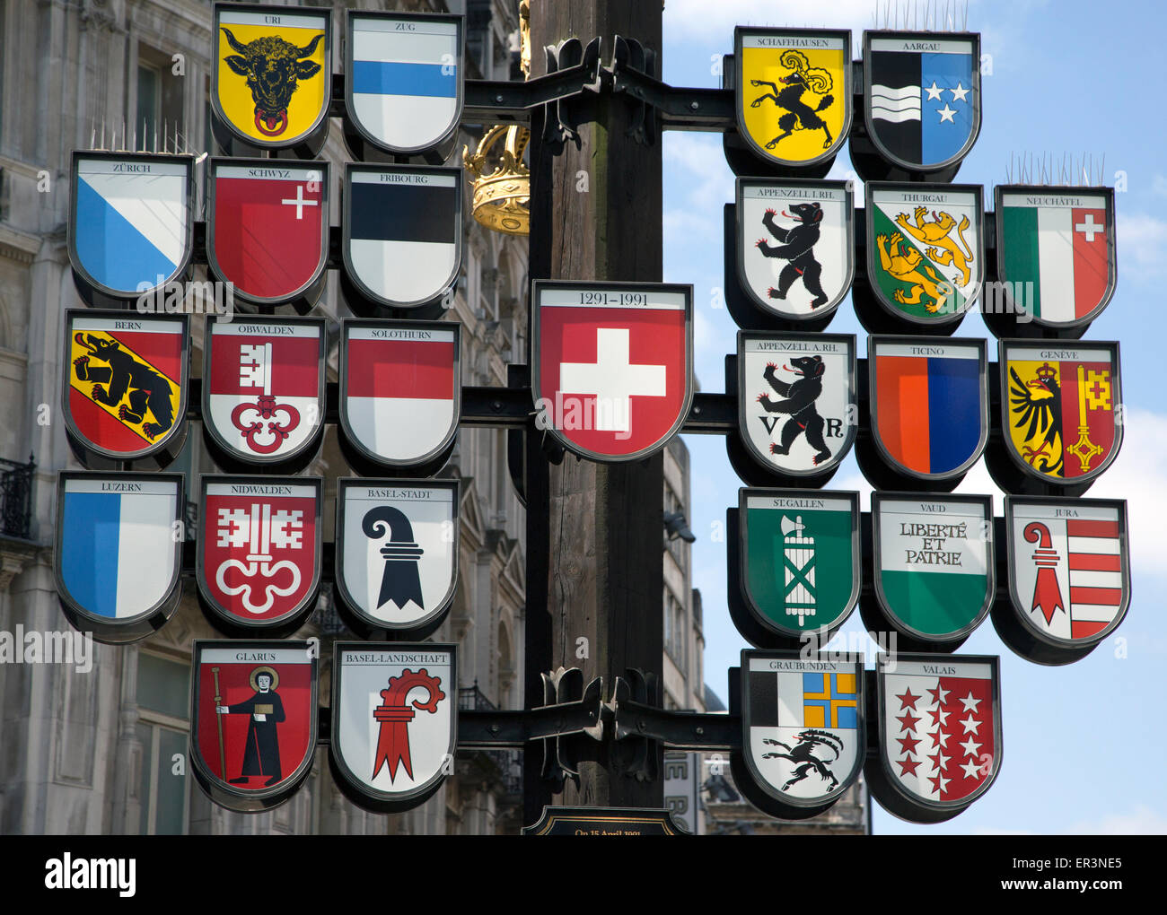 Cantonal Tree in Leicester Square London with coats of arms of 26 cantons of Switzerland - Stock Image