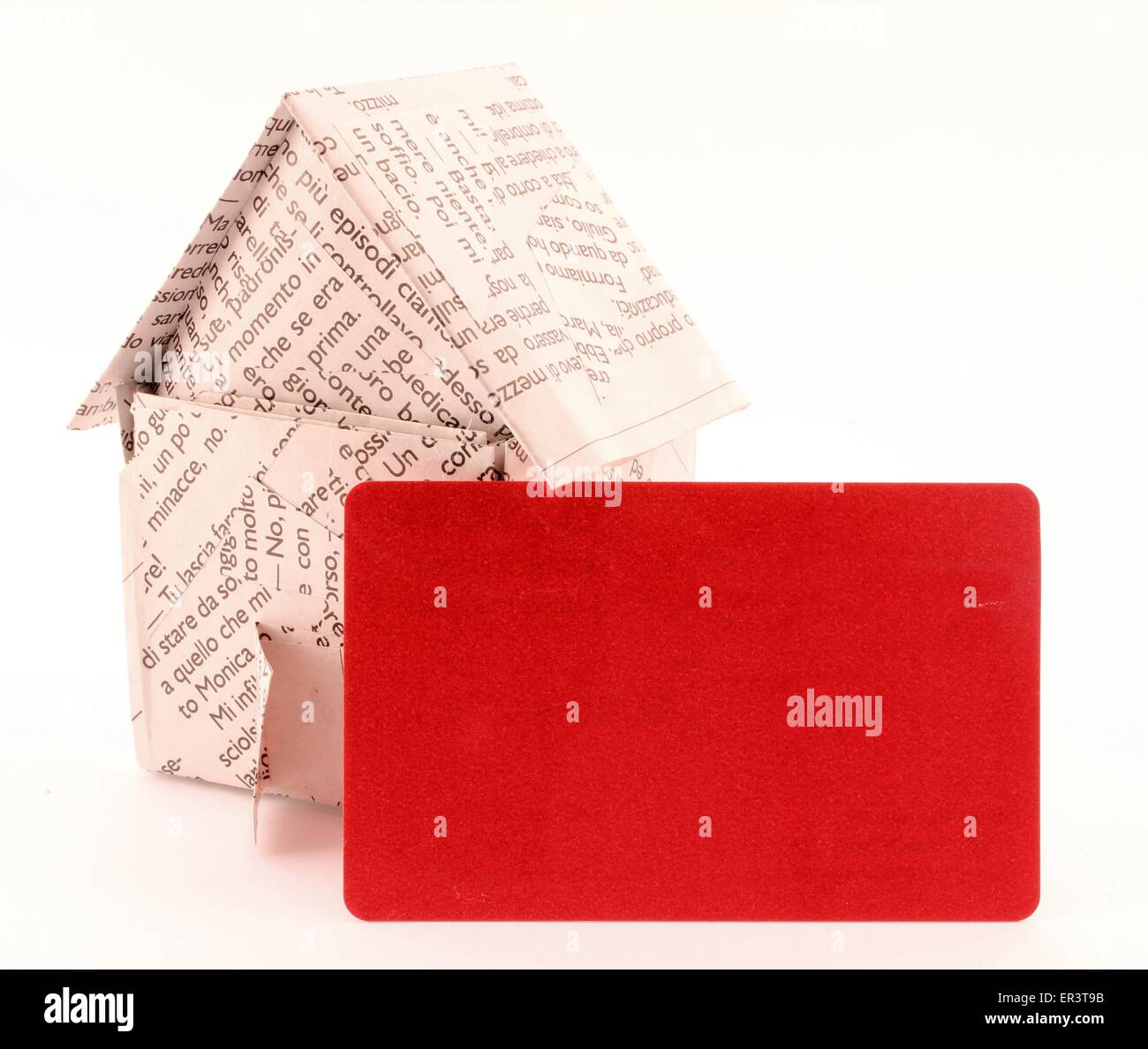 A red ticket for the description of real estate, paper house. - Stock Image