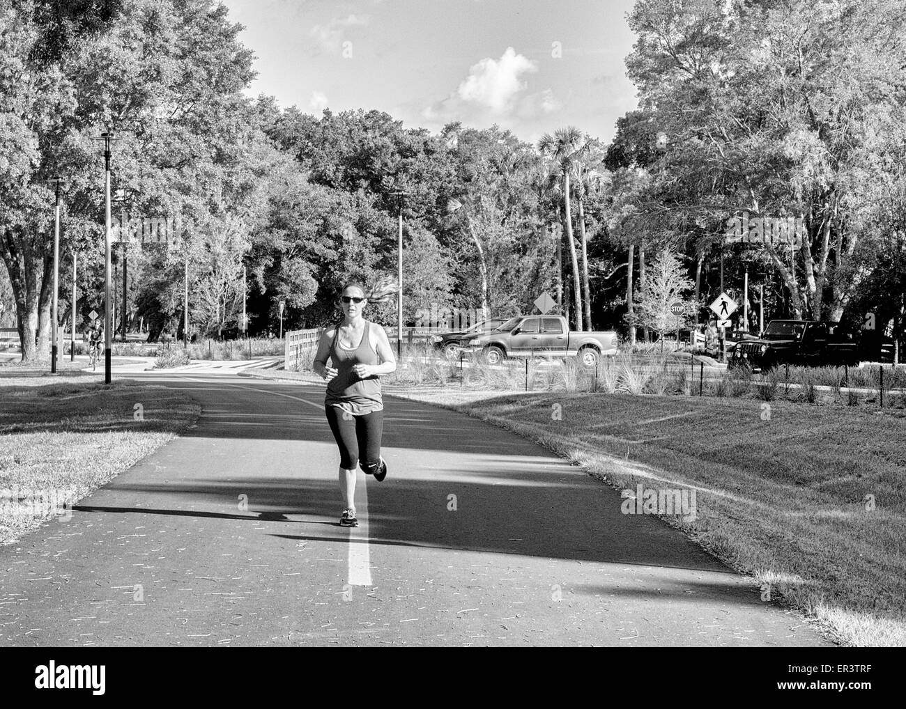 Woman jogging/running for exercise.  the image is black and white - Stock Image