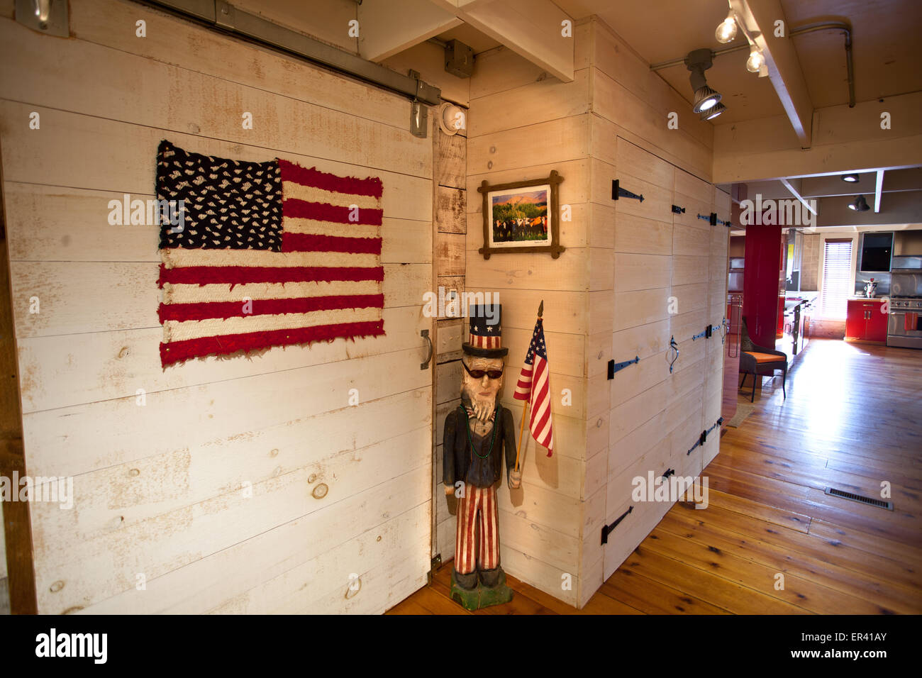 Interior detail. Vermont dairy barn renovated into a unique home featuring folk art decor. - Stock Image
