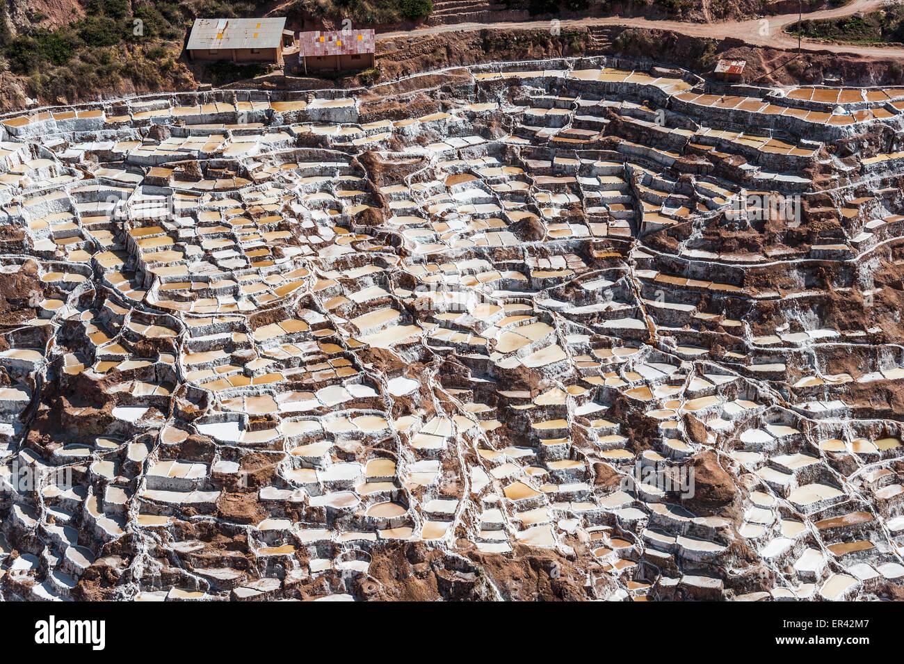 Salinas de Maras, the traditional inca salt field in Maras near Cuzco in Sacred Valley, Peru - Stock Image
