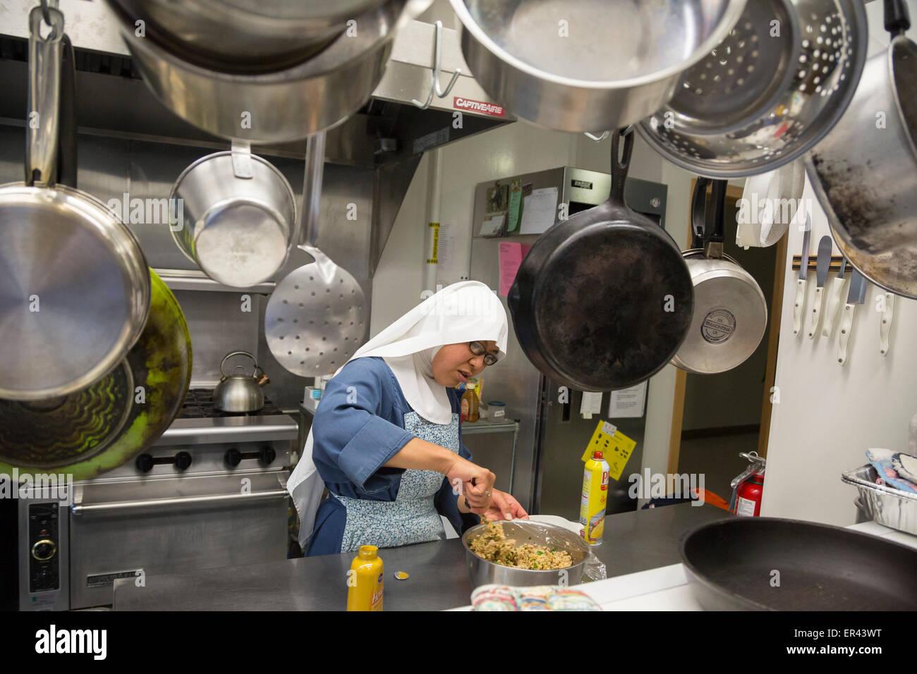 Virginia Dale, Colorado - Sister Maria Josepha prepares food in the kitchen of the Abbey of St. Walburga. - Stock Image