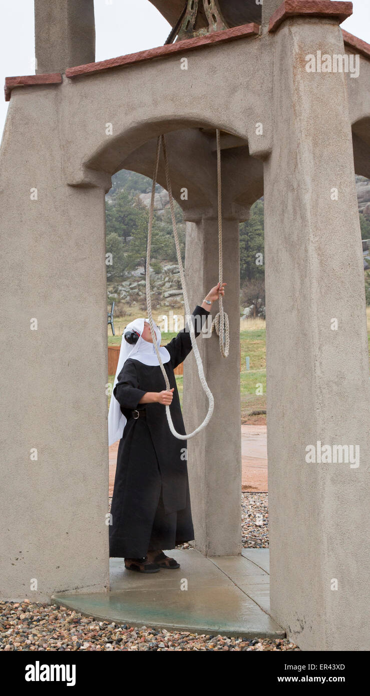 Virginia Dale, Colorado - Sister Ann rings the bells at the Abbey of St. Walburga, where Dominican nuns run a cattle - Stock Image