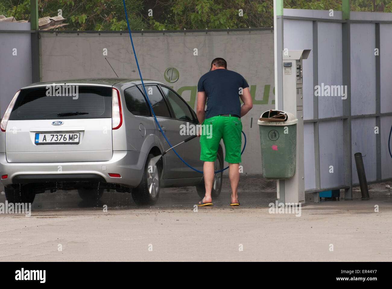 Wash station stock photos wash station stock images alamy a man washing his car at self service car wash station stock image solutioingenieria Image collections