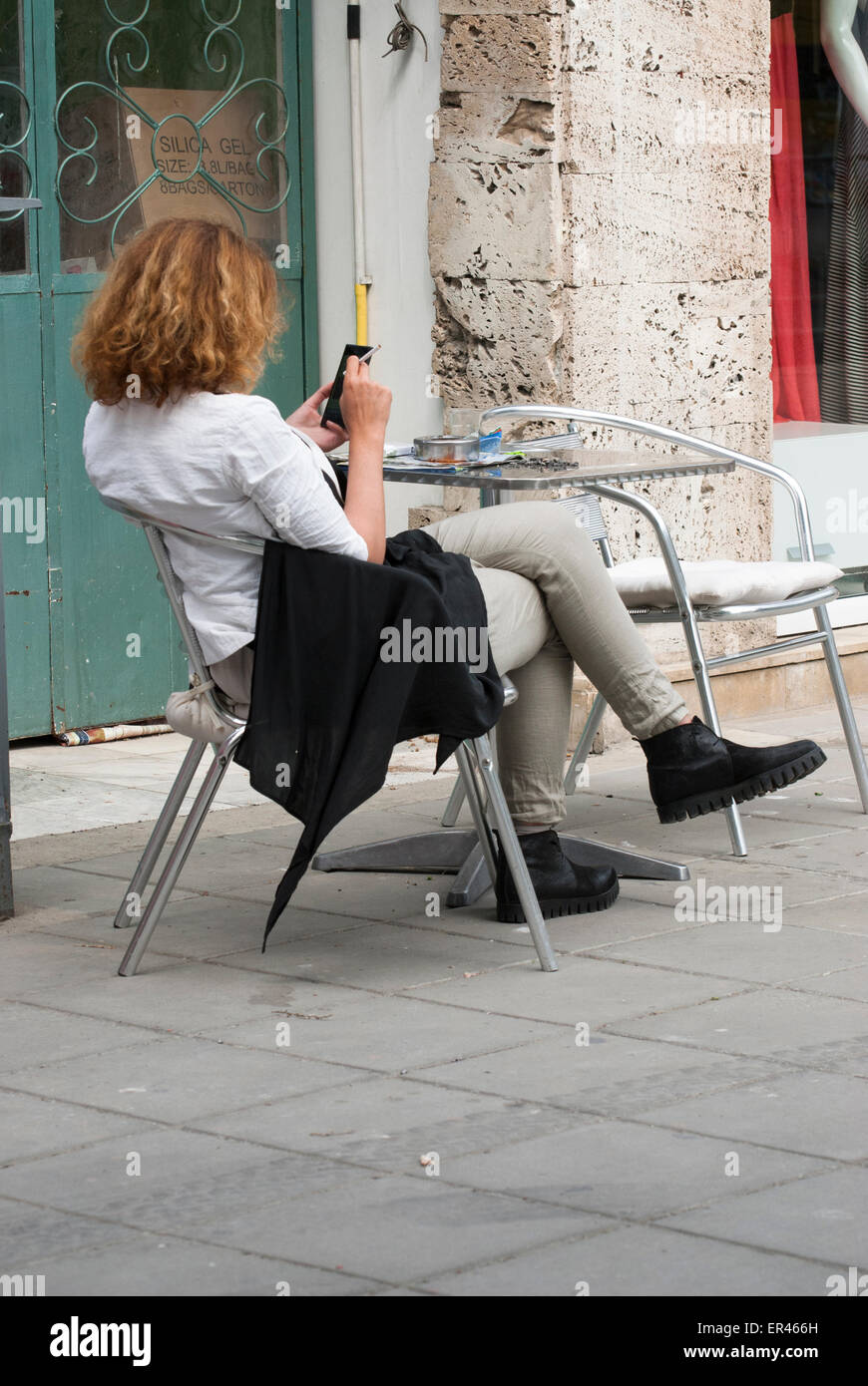 Woman watching a phone - Stock Image