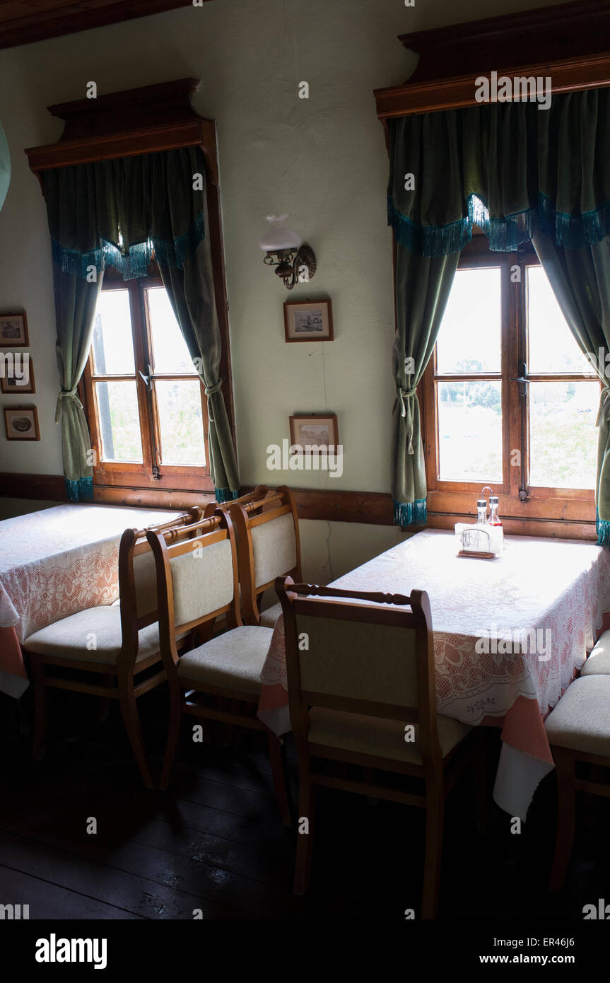 Indoor photo of restaurant tables in old house of Nessebar, Bulgaria - Stock Image