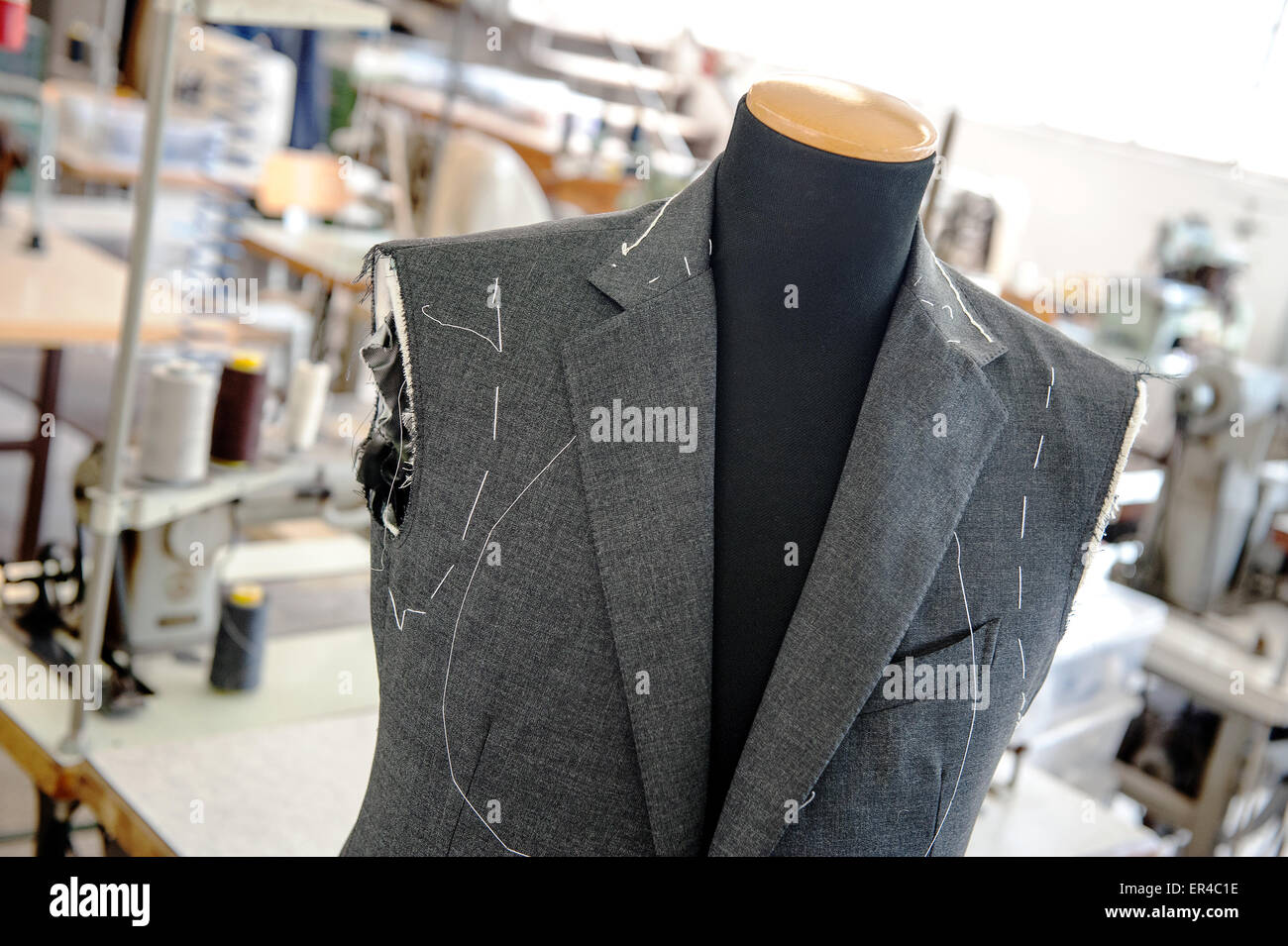 Close Up of Custom Made Hand Sewn Jacket in Progress on Mannequin Inside Clothing Manufacturing Factory or Shop - Stock Image